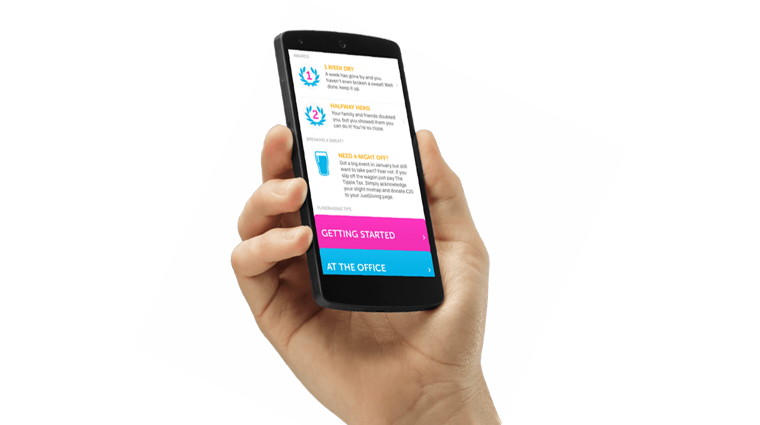 A hand holding an iPhone with a screenshot of an app created with CharityKit