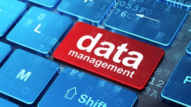 Information concept: Data Management on computer keyboard backgr