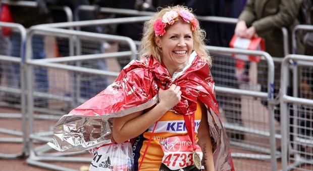 London Marthon runner wearing medal at finish line